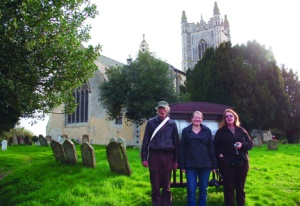 The Fuller clan in front of Redenhall Church - Kenny Fuller, his daughter, DeAnna Fuller Pasdyk, and Dawn Fuller Carignan.